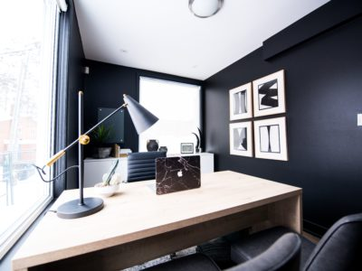 Sleek room with desk and black walls