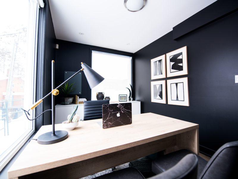 Sleek room with desk and black walls