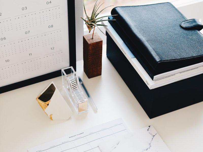 Desk with calendar on computer